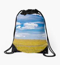 Yellow fields under blue cloudy sky Drawstring Bag