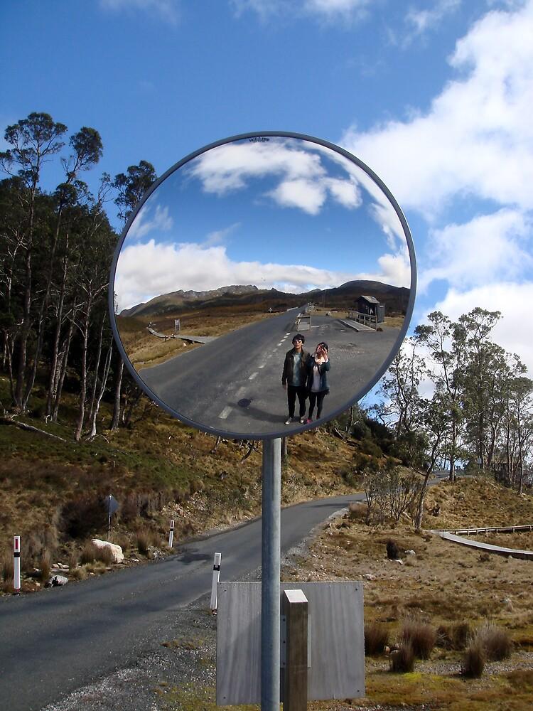 Travelers in the Road Mirror by Karen Topacio