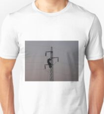 Worker on power line pylon T-Shirt