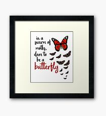 In a swarm of moths, dare to be a butterfly Framed Print
