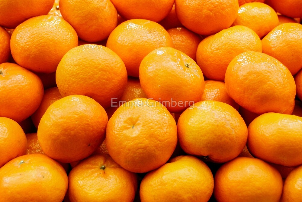 Pile of ripe clementines by Emma Grimberg