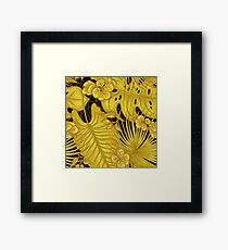 Gold leaves of tropical plants, exotic flowers Framed Print