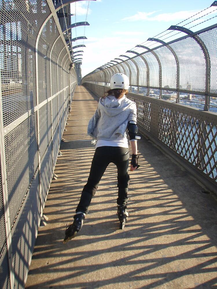 Girl rollerblading / inline skating across the Sydney Harbour Bridge - rollerbladingsydney.com by rollerblading