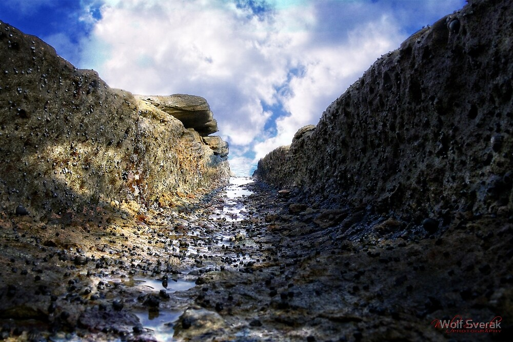 Washed Out Rock Formation on the Beach by Wolf Sverak