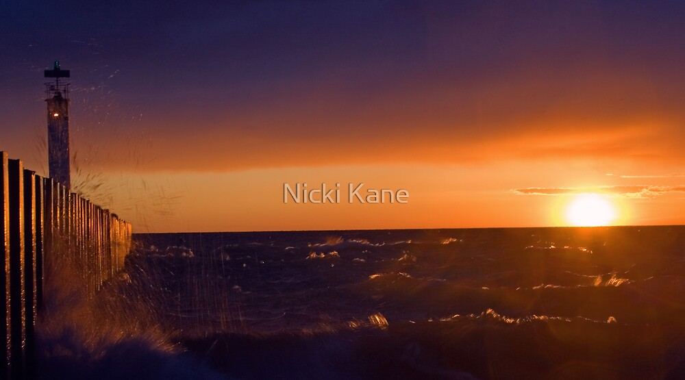Sun Set In Grand Bend With Light House and Pier by Nicki Kane