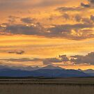High Plains Meet the Rocky Mountains at Sunset by Bo Insogna