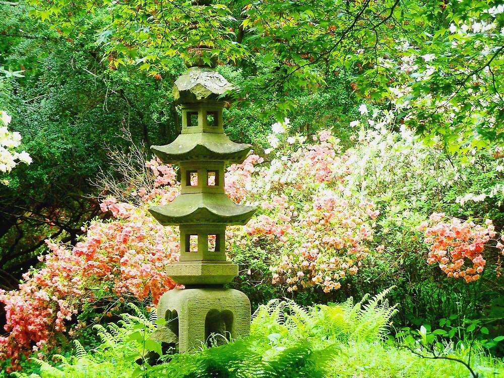 Statue in Flower garden by Judi Taylor