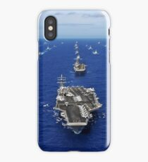 Aircraft carrier USS Ronald Reagan transits the Pacific Ocean with a fleet of ships. iPhone Case/Skin