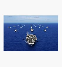 Aircraft carrier USS Ronald Reagan transits the Pacific Ocean with a fleet of ships. Photographic Print