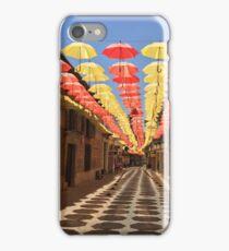 Street of Yellow and Red Hanging Umbrellas in Valdepeñas, Spain iPhone Case/Skin