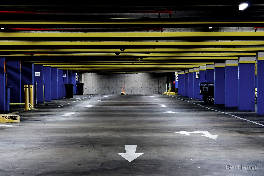 Empty Car Park Blue Yellow by Ben Herman