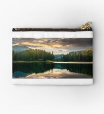 pine forest and lake near the mountain early in the morning Studio Pouch