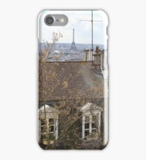 Views of the Eiffel Tower over Parisian rooftops iPhone Case/Skin