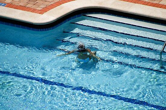 Woman in Pool Underwater by Mark Payne