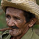 Cuban farmer and Cigar, Vinales, Cuba by David Carton