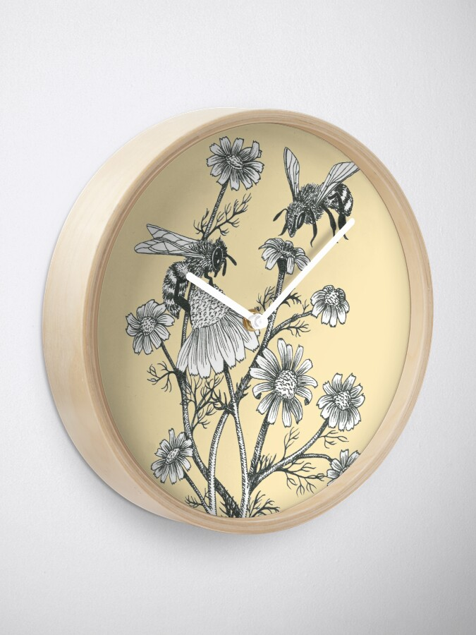 Alternate view of bees and chamomile on honey background  Clock