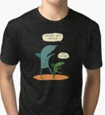 Things get weird. Tri-blend T-Shirt