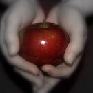 HOLDING AN APPLE by Sharon A. Henson