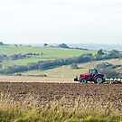 Tractor Ploughing Field by Sue Robinson