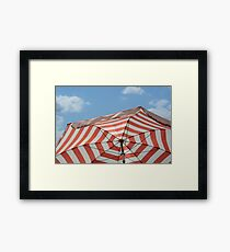 Red striped umbrella Framed Print