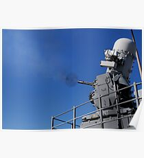 A Close-In Weapons System is fired aboard USS Bunker Hill. Poster