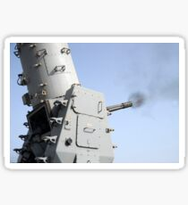 A close-in weapons system fires during an operational test aboard USS Vicksburg. Sticker