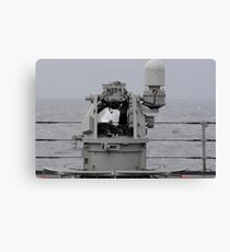 A 25mm machine gun is fired aboard USS Blue Ridge. Canvas Print