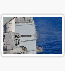 USS Monterey fires a close-in weapons system. Sticker