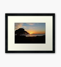 Sunrise reflections over the water Framed Print