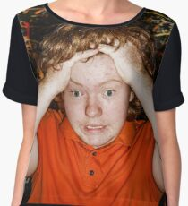 Red-haired boy taking his head showing catastrophe situation, studio Women's Chiffon Top
