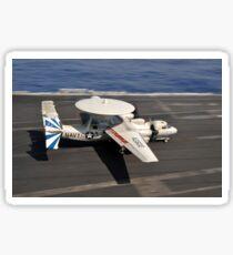 An E-2C Hawkeye lands aboard the aircraft carrier USS Dwight D. Eisenhower. Sticker