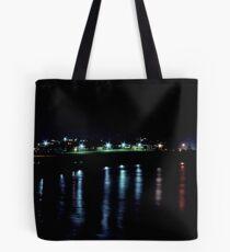 night lights on the ocean Tote Bag