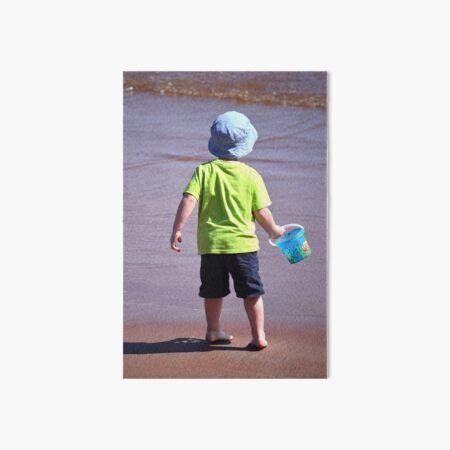 Beach Boy in Blue Hat Art Board Print