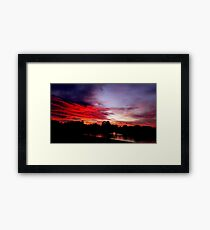 Stormy Red Sunset Framed Print