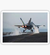 An F/A-18C Hornet launches from USS Harry S. Truman. Sticker