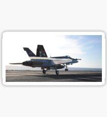 An F/A-18E Super Hornet touches the flight deck of USS Nimitz. Sticker