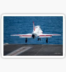 A T-45C Goshawk launches from the flight deck of USS Harry S. Truman. Sticker