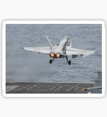An F/A-18C Hornet launches from the flight deck of USS Nimitz. Sticker