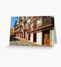 Colorful decorated facades of traditional portugal street, sunny and vivid colors Greeting Card