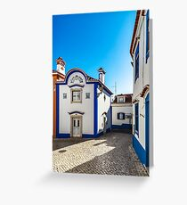 Blue color on the sky and buildings of old city Ericeira, Portugal Greeting Card