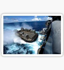 A landing craft air cushion enters the well deck of USS Bonhomme Richard. Sticker