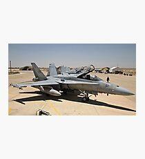 A row of U.S. Marine Corps F-18 Hornets await post-flight maintenance. Photographic Print