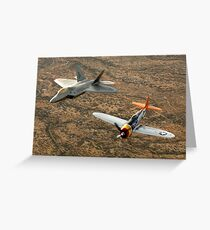 A World War II-era P-47 Thunderbolt and an F-22A Raptor fly in formation. Greeting Card