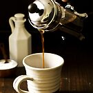 Pouring Coffee from French Press by carlacardello