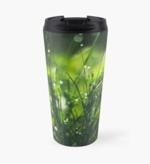 Beautiful drops of dew on the dark green grass Travel Mug
