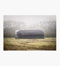Square Black Silage Bale on a Foggy Misty Evening. Photographic Print