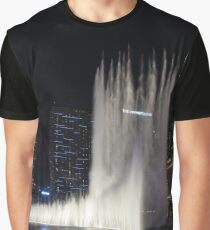 Cosmopolitan Behind the Water Curtain Graphic T-Shirt