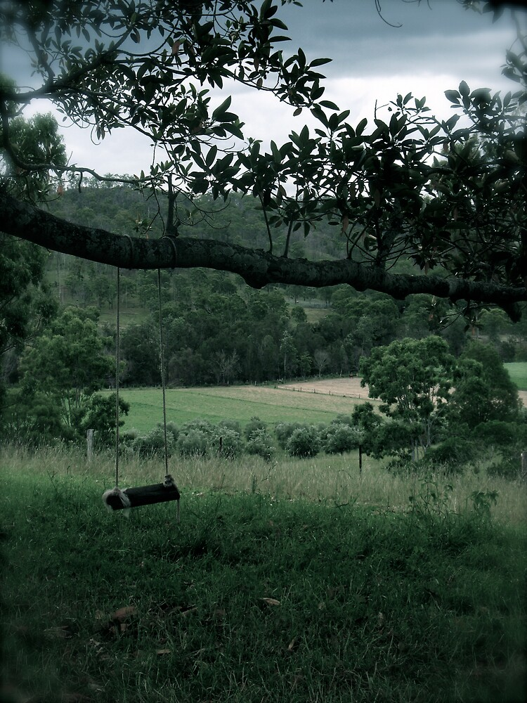 swing on a hill by Michael Gray