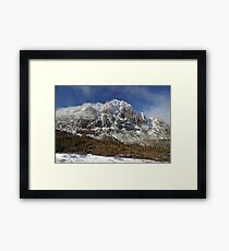 Mountain scene with snow and mist Framed Print