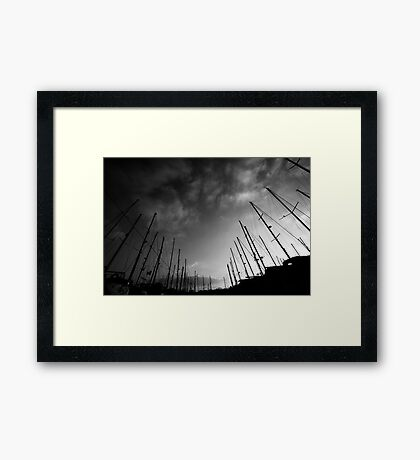 Yachts in the sky Framed Print